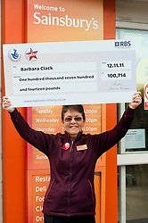 Lotto £100,714 winner Barbara outside the Sainsbury Store on  Archer Road Sheffield  where she bought her winning Lotto ticket and where she works.30 November 2011  Image © Paul David Drabble