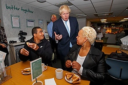 © Licensed to London News Pictures. 14/05/2015. LONDON, UK. The Mayor of London, Boris Johnson meets customers at social supermarket the Community Shop in Gipsy Hill, south London on Thursday, 14 May 2015 to announce plans to pilot similar schemes across the capital to allow members of the public buy food reduced by up to 70 per cent of normal retail prices by selling surplus products that larger retailers can't use. Photo credit : Tolga Akmen/LNP