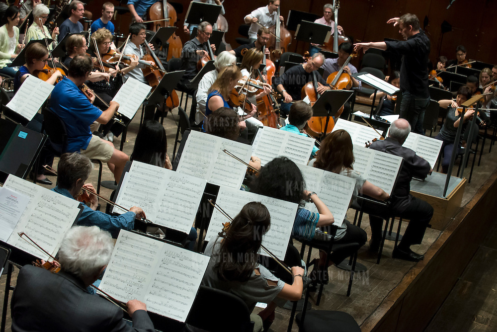 June 3, 2014 - New York, NY : Composer-conductor Matthias Pintscher, standing at right, leads the New York Philharmonic as it rehearses a piece by an up-and-coming composer at Avery Fisher Hall on Tuesday. Works by three little-known composers (one each) will be selected for inclusion in the New York Philharmonic's Biennial. CREDIT: Karsten Moran for The New York Times
