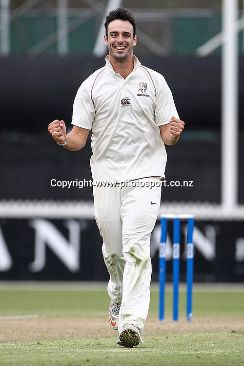 Northern Knight's Daryl Mitchell celebrates the wicket of Central Stag's Will Young during the Plunket Shield Cricket match, Northern Districts v Central Districts at Seddon Park, Hamilton. Wednesday 27 November 2013. Photo: Bruce Lim / photosport.co.nz