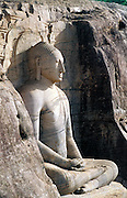 Sri Lanka. One of three statues carved in granite stone at the ancient and historic city of Polonnaruwa. Some of the finest examples of Buddhist sculpture. Polonnaruwa is A UNESCO World Heritage Site.