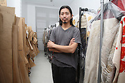 Akira Isogawa amongst his finished garments, Sydney, Australia..28.03.08