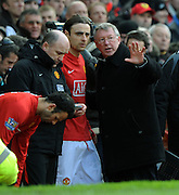 Sir Alex Ferguson makes his point to Dimitar Berbatov during the Barclays Premier League match between Manchester United and Liverpool at Old Trafford on March 14, 2009 in Manchester, England.