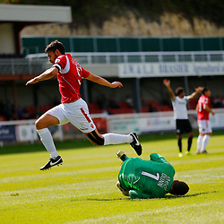 AUGUST 12:  Dover Athletic against Wrexham in Conference Premier at Crabble Stadium in Dover, England. Wrexham's goalkeeper Chris Dunn collects the ball as Wrexham's defender Shaun Pearson giudes it to him ahead of Dover's forward Ryan Bird. (Photo by Matt Bristow/mattbristow.net)