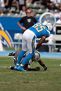 Los Angeles Chargers tight end Antonio Gates (85) is hit low by Oakland Raiders linebacker Marquel Lee (55) on a fourth quarter play in which the Raiders LB gets hit with a 15 yard roughing penalty during the NFL week 5 regular season football game against the Oakland Raiders on Sunday, Oct. 7, 2018 in Carson, Calif. The Chargers won the game 26-10. (©Paul Anthony Spinelli)
