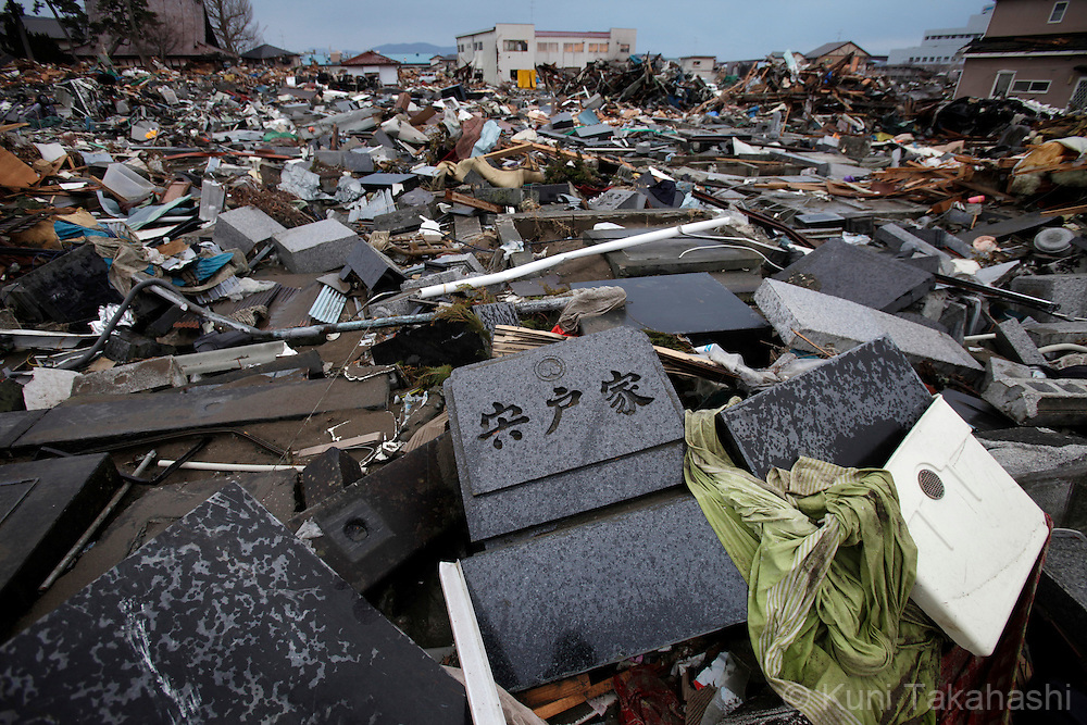 Tombstones are scattered at cemetery in Ishinomaki, Miyagi, Japan on March 31, 2011 after massive earthquake and tsunami hit northern Japan. More than 20,000 were killed by the disaster on March 11.<br /> Photo by Kuni Takahashi