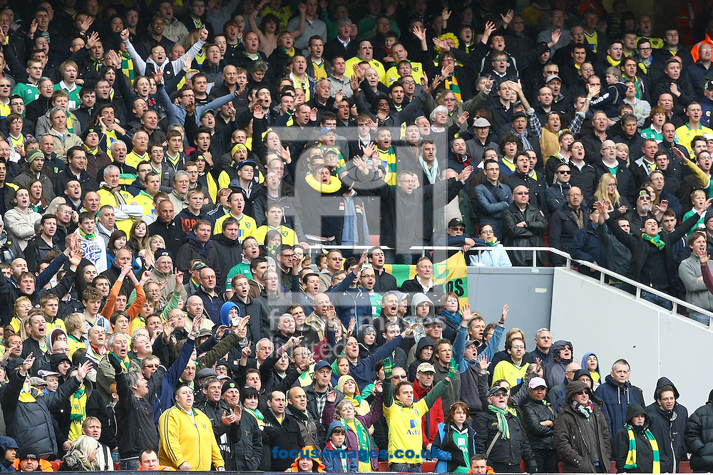 Picture by Paul Chesterton/Focus Images Ltd.  07904 640267.05/05/12.The traveling Norwich fans enjoy their day out in North London during the Barclays Premier League match at The Emirates Stadium, London.