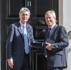 Downing Street, London, July 18th 2016. Chancellor of the Exchequer Philip Hammond welcome Chairman of chip designer ARM Stuart Chambers to no 11 Downing Street as Japan's Soft Bank takes over the company in a £24 billion deal.