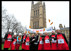 The reporters team take part in the MP's and Lords race against political Journalist in the Rehab Parliamentary Pancake Shrove Tuesday race a charity event which sees MPs and Lords joined by media types in a race to the finish. Victoria Tower Gardens, Westminster, Tuesday February 12, 2013. Photo By Andrew Parsons / i-Images
