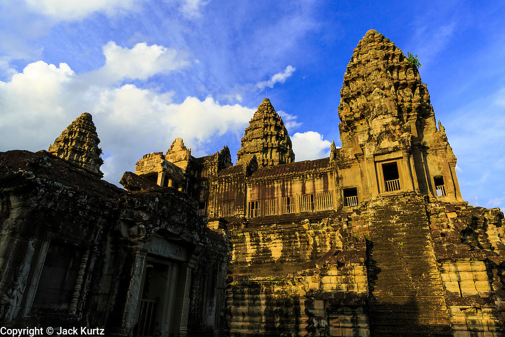 "01 JULY 2013 - ANGKOR WAT, SIEM REAP, SIEM REAP, CAMBODIA:  The center courtyard of Angkor Wat late in the afternoon. Angkor Wat is the largest temple complex in the world. The temple was built by the Khmer King Suryavarman II in the early 12th century in Yasodharapura (present-day Angkor), the capital of the Khmer Empire, as his state temple and eventual mausoleum. Angkor Wat was dedicated to Vishnu. It is the best-preserved temple at the site, and has remained a religious centre since its foundation – first Hindu, then Buddhist. The temple is at the top of the high classical style of Khmer architecture. It is a symbol of Cambodia, appearing on the national flag, and it is the country's prime attraction for visitors. The temple is admired for the architecture, the extensive bas-reliefs, and for the numerous devatas adorning its walls. The modern name, Angkor Wat, means ""Temple City"" or ""City of Temples"" in Khmer; Angkor, meaning ""city"" or ""capital city"", is a vernacular form of the word nokor, which comes from the Sanskrit word nagara. Wat is the Khmer word for ""temple grounds"", derived from the Pali word ""vatta."" Prior to this time the temple was known as Preah Pisnulok, after the posthumous title of its founder. It is also the name of complex of temples, which includes Bayon and Preah Khan, in the vicinity. It is by far the most visited tourist attraction in Cambodia. More than half of all tourists to Cambodia visit Angkor.      PHOTO BY JACK KURTZ"