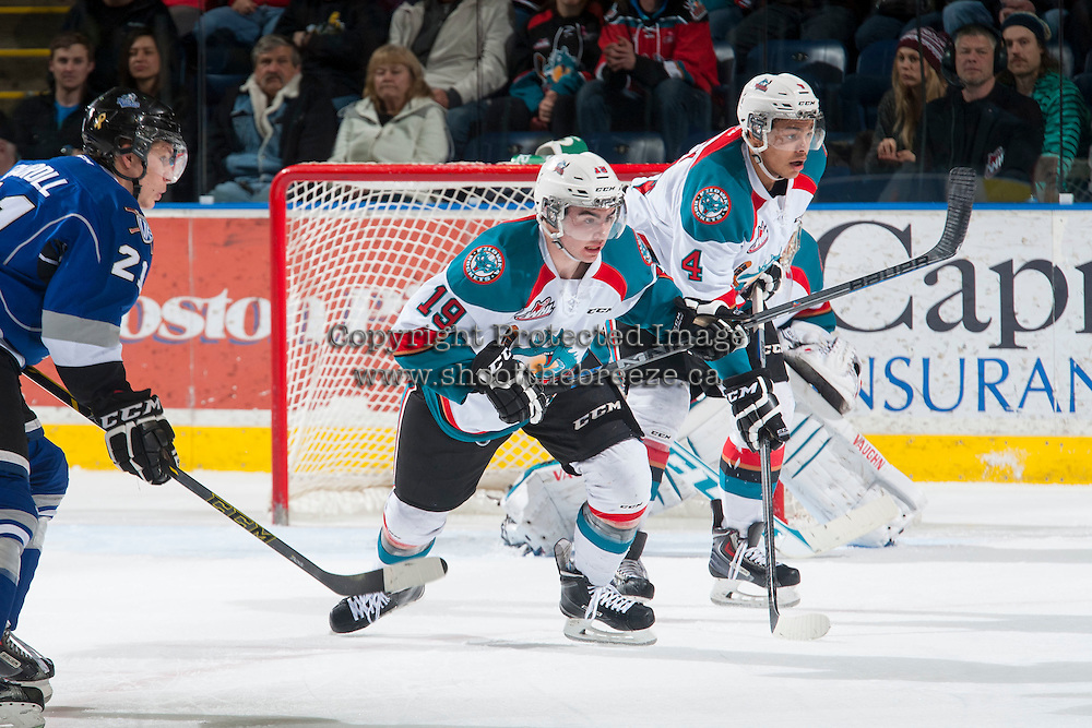 KELOWNA, CANADA - MARCH 11: Dillon Dube #19 and Madison Bowey #4 of Kelowna Rockets keep their eyes on the puck against the Victoria Royals on March 11, 2015 at Prospera Place in Kelowna, British Columbia, Canada.  (Photo by Marissa Baecker/Shoot the Breeze)  *** Local Caption *** Dillon Dube; Madison Bowey;