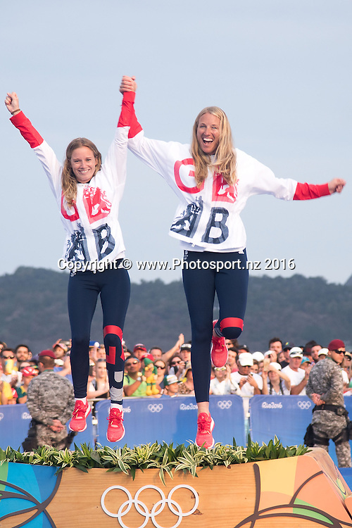 Great Britain's Hannah Mills and Saskia Clark celebrate winning Gold during the medal ceremony for 470 class sailing race the 2016 Rio Olympics on Thursday the 18th of August 2016. © Copyright Photo by Marty Melville / www.Photosport.nz