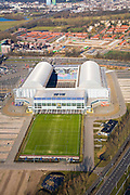 Nederland, Gelderland, Arnhem, 11-02-2008; Gelredome, overdekt voetbalstadion in de wijk Elden met Vitesse als thuisclub; het stadion wordt ook gebruikt voor concerten en evenementen; het multifunctionele superstadion heeft een verschuifbaar dak (afhankelijk van het weer is het dak geopend of gesloten) en een verplaatsbare grasbak met verschuifbaar veld; het voetbaldveld krijgt op deze wijze voldoende zonlicht, de betonnen vloer binnen kan gebruikt worden voor manifestaties e.d. zonder dat het gras beschadigd; ; stadion, voetbalclub, voetbal, manifestatie, evenement, concert, Gelredrome, gelre dome, grasmat, stadiontheater; Gelredome, covered football stadium in the district Elden with Vitesse as home club, the stadium is also used for concerts and events, the multipurpose super stadium has a moveable roof (depending on the weather, the roof is open or closed) and a movable grasbak with moveable field;this way the football field gets sufficient sunlight; .the concrete floor inside can be used for events without the grass being damaged; stadium, football, soccer, event, event, concert.luchtfoto (toeslag); aerial photo (additional fee required); .foto Siebe Swart / photo Siebe Swart