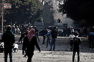 EGYPT, Cairo : Egyptian protesters throw stones toward security forces during clashes with near the Egyptian Interior Ministry in Cairo, Egypt, Sunday, Feb. 5, 2012.