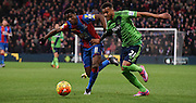 Wilfred Zaha and Ryan Bertrand battle for the ball during the Barclays Premier League match between Crystal Palace and Southampton at Selhurst Park, London, England on 12 December 2015. Photo by Michael Hulf.