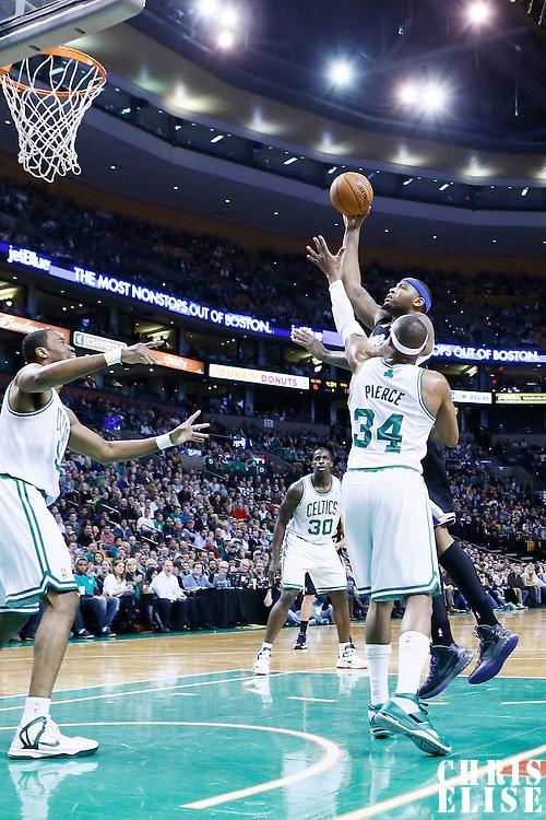 30 January 2013: Sacramento Kings center DeMarcus Cousins (15) goes for the skyhook over Boston Celtics small forward Paul Pierce (34) during the Boston Celtics 99-81 victory over the Sacramento Kings at the TD Garden, Boston, Massachusetts, USA.