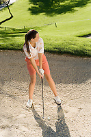 Golfer Preparing to Hit Ball in Sand Trap