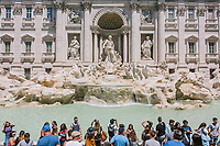 """ROME, ITALY - 20 JUNE 2017: Tourists are seen here at the Trevi Fountain in Rome, Italy, on June 20th 2017.<br /> <br /> The warm weather has brought a menacing whiff of tourists behaving badly in Rome. On April 12, a man went skinny-dipping in the Trevi fountain resulting in a viral web video and a 500 euro fine.<br /> <br /> Virginia Raggi, the mayor of Rome and a national figurehead of the anti-establishment Five Star Movement,  issued an ordinance involving harsher fines for eating, drinking or sitting on the fountains, for washing animals or clothes in the fountain water or for throwing anything other than coins into the water of the Trevi Fountain, Bernini's Four Fountains and 35 other city fountains of artistic or historic significance around the city.  """"It is unacceptable that someone use them to go swimming or clean themselves, it's an historic patrimony that we must safeguard,"""" Ms. Raggi said."""