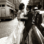 Sepia Black & White photo of Bride and groom romantic together in cobblestone SoHo NYC street