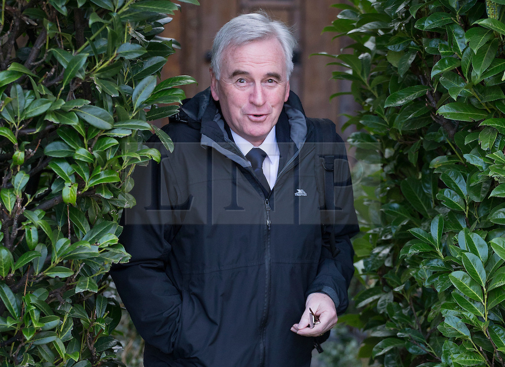 © Licensed to London News Pictures. 16/03/2016. London, UK.  Labour Shadow Chancellor John McDonnell leaves home for Parliament on Budget day. Later Chancellor George Osborne will deliver his eighth budget to MPs.  Photo credit: Peter Macdiarmid/LNP