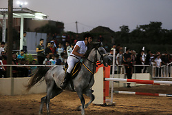 August 4, 2017 - Gaza, Palestine - A Palestinian boy rides his horse during a jump obstacles championship, in Gaza city on August 4, 2017  (Credit Image: © Momen Faiz/NurPhoto via ZUMA Press)