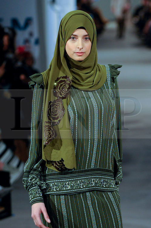 © Licensed to London News Pictures. 18/02/2017. London, UK.  A model presents a look by Ummiriaz (Malaysia) at the UK's first London Modest Fashion Week taking place this weekend at the Saatchi Gallery.  The two day event sees 40 brands from across the world come together to showcase their collections for Muslim and other religious women. Photo credit : Stephen Chung/LNP