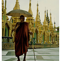 An old monk walks on the terrace of Shwedagon Paya, days after the massive protest of monks through the streets of Rangoon. Wednesday, October 3, 2007. Rangoon, Myanmar (Burma)