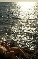 on the rocky beach, Manarola, Cinqueterre, Italy<br /> <br /> photo by Owen Franken <br /> <br /> www.owenfranken.com
