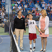 August 21, 2014, New Haven, CT:<br /> AETNA guests participate in a coin toss before a match between Samantha Stosur and Kirsten Flipkens on day seven of the 2014 Connecticut Open at the Yale University Tennis Center in New Haven, Connecticut Thursday, August 21, 2014.<br /> (Photo by Billie Weiss/Connecticut Open)