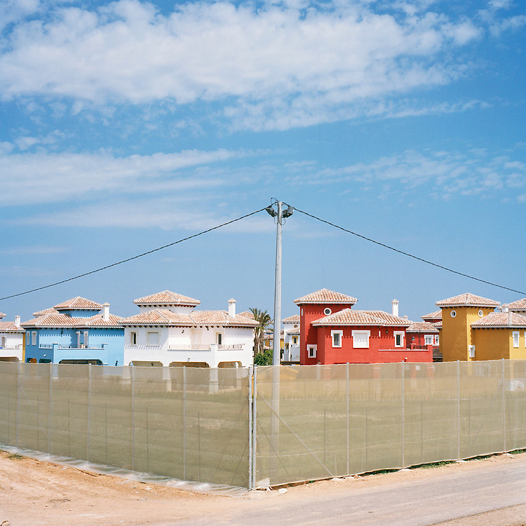 Murcia, Spain. From a story on the explosion of controversial golf resorts in Spain's arid south-east. These walled developments are often built on former farming land when farmers sell their land to the big developers. Most of these new houses are sold to foreign buyers as holiday homes..Photo shows a Polaris World Mar Menor Golf Resort in Murcia, Spain..Photo©Steve Forrest/Amaya Roman