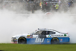 November 3, 2018 - Ft. Worth, Texas, United States of America - Cole Custer (00) takes the checkered flag and wins the O'Reilly Auto Parts Challenge at Texas Motor Speedway in Ft. Worth, Texas. (Credit Image: © Justin R. Noe Asp Inc/ASP via ZUMA Wire)