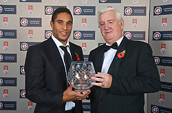 CARDIFF, WALES - Wednesday, November 11, 2009: Wales' Ashley Williams with the Welsh Club player of the Year award presented by President Phil Pritchard during the Football Association of Wales Player of the Year Awards hosted by Brains SA at the Cardiff City Stadium. (Pic by David Rawcliffe/Propaganda)