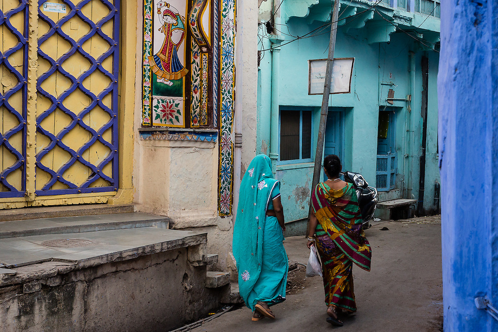 Two women walk through one of the many colorful streets of Bundi.