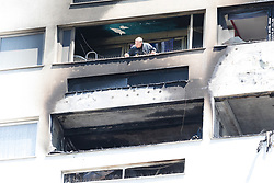 © Licensed to London News Pictures. 29/06/2018. London, UK.  A fire fighter looks out a burnt flat at the scene at Grafton House in Bow, east London where a fire broke out earlier today.  Photo credit: Vickie Flores/LNP