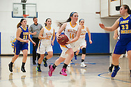 Milton's Kate Rowley (14) drives to the hoop past Lamoille's Tara Barney (23) during the girls basketball game between Lamoille and Milton at Milton High School on Friday night December 18, 2015 in Milton, (BRIAN JENKINS/for the FREE PRESS)