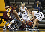 February 18, 2010: Iowa forward Kelsey Cermak (22) grabs a lose ball as Minnesota forward Jackie Voigt (45), Iowa guard Kachine Alexander (21) and Iowa guard Jaime Printy (24) close in during the first half of the NCAA women's basketball game at Carver-Hawkeye Arena in Iowa City, Iowa on February 18, 2010. Iowa defeated Minnesota 75-54.