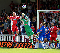 Photo: Ed Godden.<br />Swindon Town v Stockport County. Coca Cola League 2. 26/08/2006. Stockport keeper Andy Nicholas keeps out James Spencer's header.