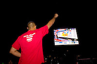A Barack Obama supporter celebrates as poll numbers were being announced as supporters take to Chicago's Grant Park for the election night results for the presidential race between Sen. Barak Obama (D-IL) and Sen. John McCain (R-AZ) Tuesday Nov. 4, 2008 Chicago IL.