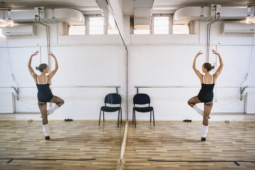 Etrita Abdullahu (15), a ballet student, watchs her move in the mirror during rehearsal at the training room of Kosovo Ballet, Kosovo National Theater, Pristina.
