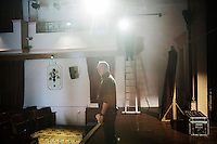 SLIEMA, MALTA - 8 FEBRUARY 2016: Stage manage Dave McEvoy checks the lighting on stage for the touring Hamlet, performed by the Shakespeare's Globe theatre company, at the Salesian Theatre in Sliema, Malta, on February 8th 2016.<br /> <br /> The touring Hamlet, performed by the Shakespeare's Globe theatre company, is part of the Globe to Globe tour that set off in April 2014 (on the 450th anniversary of Shakespeare's birth) with the ambitious intention of visiting every country in the world over 2 years. The crew is composed of a total of sixteen men and women: four stage managers and twelve twelve actors  actors perform over two dozen parts on a stripped-down wooden stage. So far Hamlet has been performed in over 150 countries, to more than 100,000 people and travelled over 150,000 miles. The tour was granted UNESCO patronage for its engagement with local communities and its promotion of cultural education. Hamlet was also played for many dsiplaced people around the world. It was performed in the Zaatari camp on the border between Syria and Jordan, for Central African Republic refugees in Cameroon, and for Yemeni people in Djibouti. On February 3rd it was performed to about 300 refugees in Calais at the camp known as the Jungle.