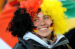 A german fan wearing a wig during the 2010 FIFA World Cup South Africa Group D match between Ghana and Germany at Soccer City Stadium on June 23, 2010 in Johannesburg, South Africa.