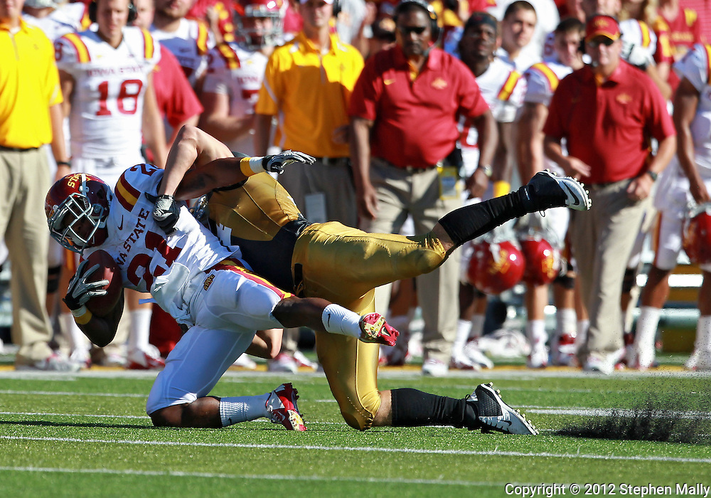 September 08 2012: Iowa State Cyclones running back Shontrelle Johnson (21) is hit by Iowa Hawkeyes linebacker James Morris (44) during the third quarter of the NCAA football game between the Iowa State Cyclones and the Iowa Hawkeyes at Kinnick Stadium in Iowa City, Iowa on Saturday September 8, 2012. Iowa State defeated Iowa 9-6.