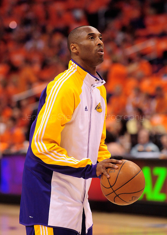 May 29, 2010; Phoenix, AZ, USA; Los Angeles Lakers guard Kobe Bryant (24) shoots a free throw during warm ups prior to the first quarter in game six of the western conference finals in the 2010 NBA Playoffs at US Airways Center.  Mandatory Credit: Jennifer Stewart-US PRESSWIRE