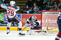 KELOWNA, CANADA - MARCH 27: Eric Comrie #1 of Tri-City Americans makes a save against the Kelowna Rockets on March 27, 2015 at Prospera Place in Kelowna, British Columbia, Canada.  (Photo by Marissa Baecker/Shoot the Breeze)  *** Local Caption *** Eric Comrie;