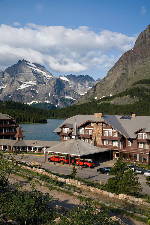 Many Glacier Hotel on Swiftcurrent Lake, with historic Red Buses under the port cochere.  The Red Buss are considered the symbol of GNP and are fresh from a full restoration by the Ford Motor Company.  Built between 1936-39, they have tops that roll back for an incredible sightseeing experience.