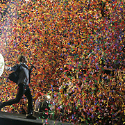 CHRIS MARTIN OF COLDPLAY  ENGULFED IN THOUSANDS OF CONFETTI BUTTERFLIES AS THE BAND ENDED THEIR TOUR AT WEMBLEY.