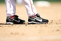 5 May 2007:  Nike baseball cleats in the dirt at third base. MLB Angels at Angel Stadium. Baseball details.