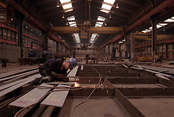 Govan Shipyard. <br /> File photo of a welder at work at Govan shipyard on the banks of the River Clyde in Glasgow, Scotland, UK. The future of some of Britain's shipyards is in doubt after BAE said it aims to cut up to 1,000 jobs from the three shipyards, including Govan, Photo taken March 1999. Filed Wednesday, 6th November 2013. Picture by Jonathan Mitchell / i-Images