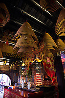 Altars crowded with offerings and large coiled incense burning slowly give Tin Hau Temple in Hong Kong its atmosphere.