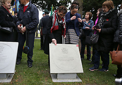 Josephine Hughes touches a plaque unveiled commemorating her uncle, Private Thomas Hughes VC, at a Wreath Laying ceremony to commemorate Armistice Day at the Glasnevin cemetery in Dublin.